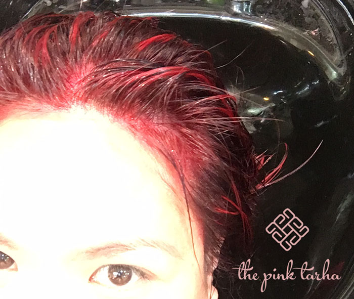 The bright red color that was put on my hair first. O.O